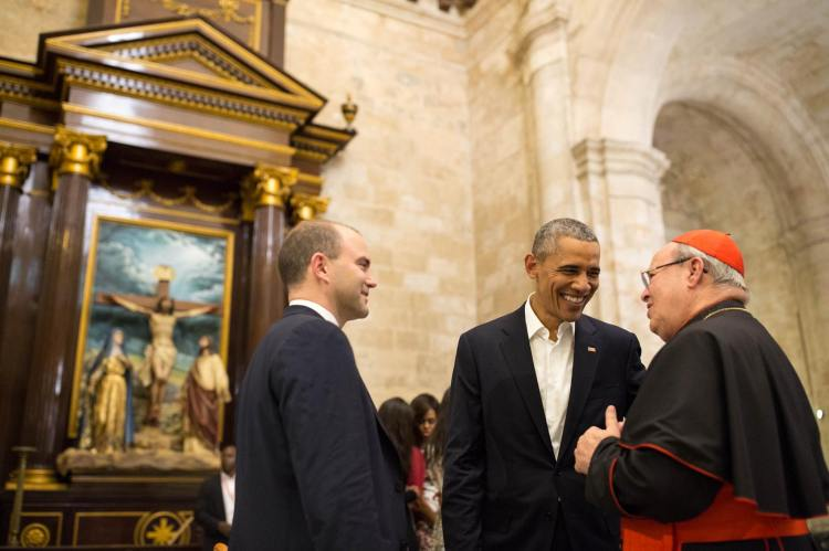 The Archbishop of Havana, Cardinal Jamie Ortega, has announced his retirement a few weeks after helping to negotiate normalized relations between Cuba and the USA, and welcoming President Obama to his Cathedral of the Virgin Mary of the Immaculate Conception. Above: with the President and Ben Rhodes, deputy national security adviser. (Pete Souza/The White House)