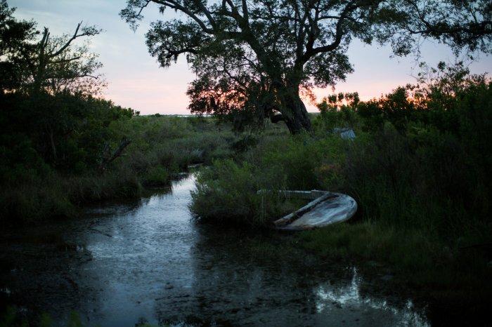 Abandoned boat on Isle de Jean Charles (Josh Haner/The New York Times)