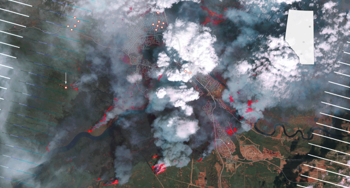 A satellite photo earlier this week of Fort McMurray, Alberta, where a raging wildfire has wiped out half the city of 80,000 and forced a total evacuation with only one road out. (U.S. Forest Service, University of Wisconsin at Madison; Tim Wallace/The New York Times)