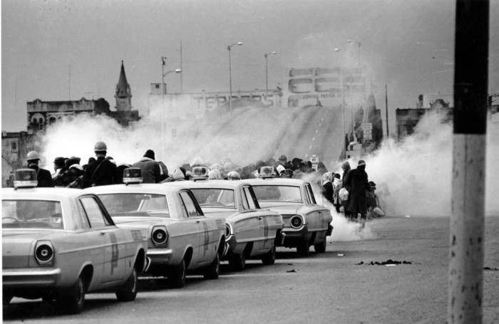 Clouds of tear gas fired by state police on civil rights marchers at the Edmund Pettus Bridge in Selma, Alabama on 7 March 1965. Police beat these peaceful citizens without mercy for demanding the right to vote. (Associated Press)
