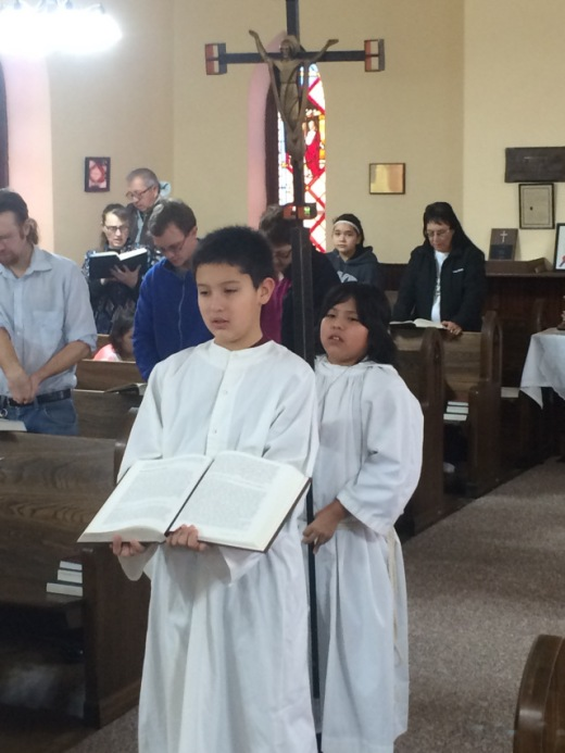 Slade and Mauricio, acolytes at Trinity Church, Mission, South Dakota. Slade is taller, but this was his first time of serving; Mauricio is smaller but he's the senior acolyte. (The Rev. Dr. Lauren Stanley)