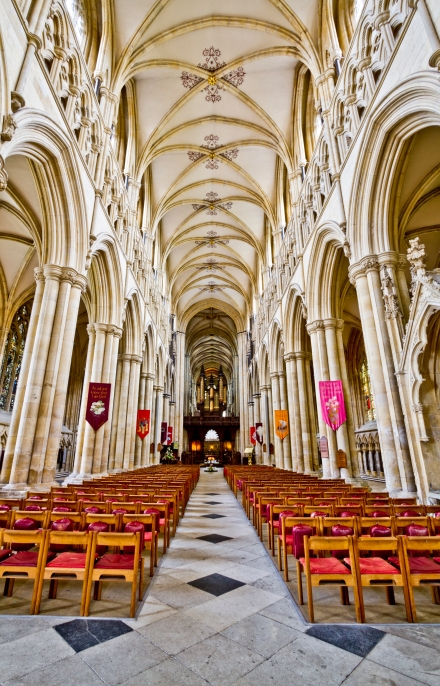 The nave at Beverley Minster in North Yorkshire. Begun as a monastery around 700, the present Grade I listed building, in Perpendicular style, was erected starting about 1220. (Wikipedia)