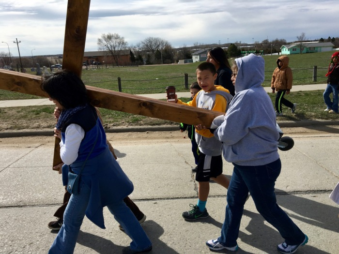 Children and community members carried the cross through the streets of Mission, South Dakota on Good Friday, sponsored by Rosebud Episcopal Mission on the Lakota Sioux Indian Reservation. Our gifts to the Rez support a summer day camp and heating supplies during the bitterly cold winters. (The Rev. Lauren M. Stanley)