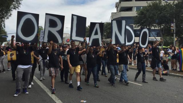 The LGBT Pride Parade in West Hollywood marched for Orlando yesterday, a few hours after a heavily-armed Indiana man was arrested in Santa Monica, reportedly intending to harm to harm them. (Hailey Branson-Potts/Los Angeles Times)