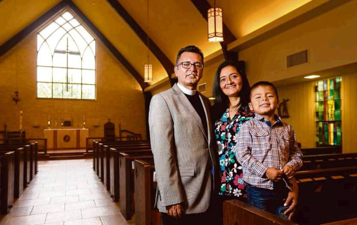 """The Houston Chronicle on Sunday ran a big story on two local Episcopal priests, Frs. Pedro and Uriel Lopez, whose parishes are helping to lead significant growth in Latino ministry in the Diocese of Texas. They are brothers, formerly priests in the Roman Catholic Church, who left to become Episcopalians, marry and have families. They feel their lives are more balanced now, that family life helps them carve out time away from the constant demands on the clergy. Our Honorary Deacon Clint, a parishioner of Fr. Pedro's, says, """"These guys are going places in the diocese.""""  Above: Fr. Uriel with wife Lucia and son Carlos of St. Christopher's, Houston. (Gary Coronado/Houston Chronicle)"""