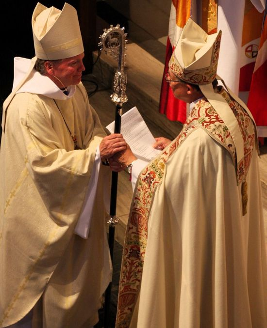 The handoff: the Rt. Rev. Edward S. Little II, the VII Bishop of Northern Indiana, passed the crozier to his sucessor, the Rt. Rev. Doug Sparks, VIII Bishop, on 25 June. (Wikipedia)