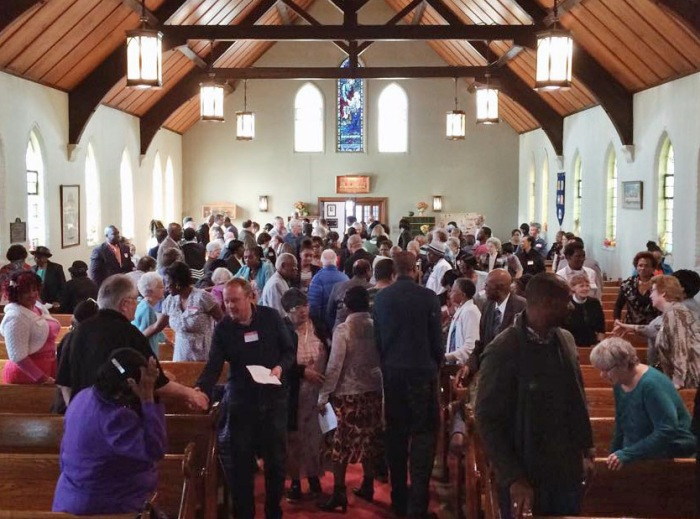 St. Mary and Martha Church, Mount Dennis, Toronto, passing the peace at their first Eucharist last October. (parish photo)