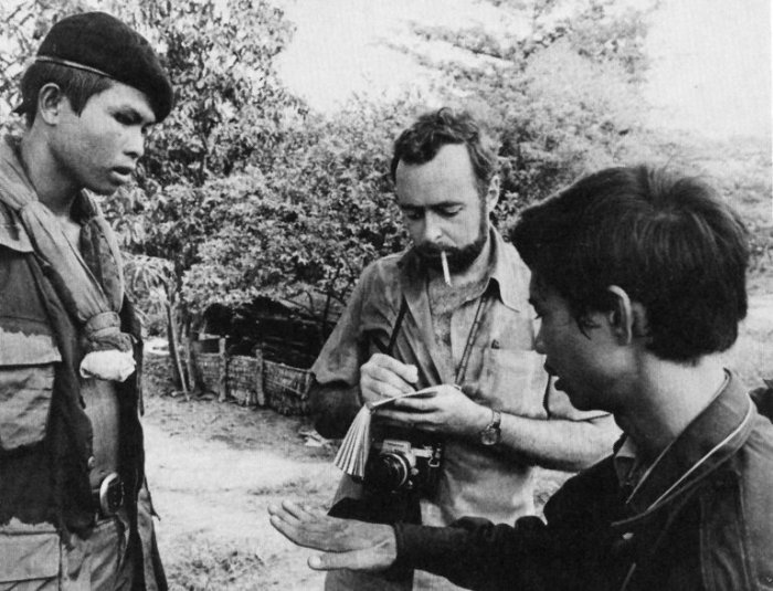 "Sydney H. Schanberg (center), the Pulitzer Prize-winning war correspondent for The New York Times, has died at 82, having exposed ""The Killing Fields"" of Cambodia in the 1970s with his translator and friend Dith Pran (right). The United States bombed Cambodia in 1973 as part of a Vietnam-related intervention into Cambodia's civil war; U.S. technology and military might could not prevent the Khmer Rouge from toppling the government, setting off a genocide so deadly as to rank near the Holocaust in its brutality. Told by their superiors in New York, Schanberg and Pran remained at work and were seized by Pol Pot's teenage soldiers. They ended up at the French Embassy, though Pran was later expelled with other Cambodians as the French themselves became targets; Schanberg and other foreigners were evacuated to Thailand, where he reported on the fall of Phnom Penh and the complete expulsion of the city of two million. He made his way back to the USA and helped Pran's wife and children establish a new life in San Francisco. After many sufferings, Dith Pran was able to escape to Thailand and reunited with his family and his mentor. Schamberg wrote a Times magazine story, ""The Death and Life of Dith Pran,"" which was later released as a book, then made into a film starring Sam Waterston and Dr. Haing S. Noor, who won an Academy Award as Best Supporting Actor. (via The New York Times)"