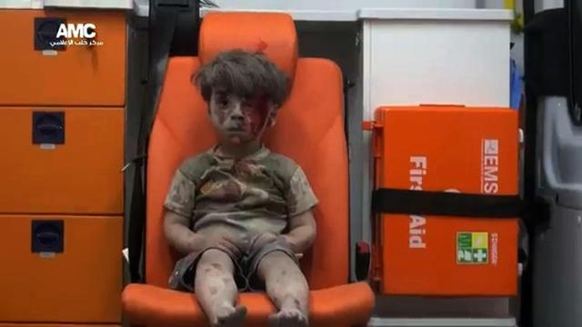 His name is Omran. He's from Aleppo. He doesn't understand why his house was blown up, hurting his entire family; or why grownups shoot and kill and bomb each other. He doesnt understand at all. But he has cried so much that now he can't think or feel anything; and neither can anyone else.
