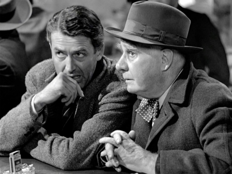 "The angel Clarence (Henry Travers) saving George Bailey (Jimmy Stewart) from suicide and bankruptcy in ""It's a Wonderful Life."" (Frank Capra)"
