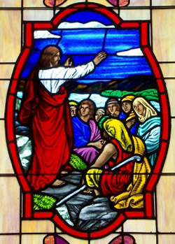 Window depicting Christ's sermon on the mount; source unknown. St. Luke's Gospel includes a series of curses as well as familiar blessings.