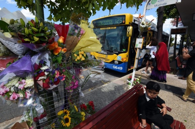 "Flowers decorated a bus stop in Moorooka, Australia last weekend after a bus driver was killed and 13 passengers were injured when a man threw a molotov cocktail on the bus. The well-liked driver, Manmeet Alisher, was an immigrant from Punjab, and suspicions were quickly raised that it was a hate crime. A man was quickly arrested, and has been described in media reports as an ""erratic loner,"" which may cast doubt on the anti-immigrant theory; either way, what a tragedy this is. (Dan Peled/European Pressphoto)"