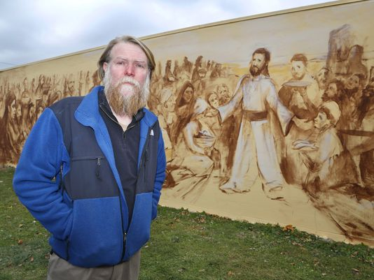 For some years now the St. James Food Pantry in Lafayette, Indiana has operated out of a small, nondescript commercial building it owns around the corner from the Lutheran Church-Missouri Synod. Most people didn't know where it was, and those who did were seldom thrilled to go inside. But this gentleman, James Werner, has fixed that with a new mural he calls Jesus Feeding the Masses. It's an ambitious undertaking and not quite finished yet, but no one's ashamed to be see there anymore, and people are proud of it. (John Terhune/Journal and Courier)