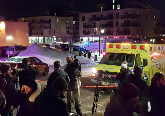 """Six people were reportedly killed by gunmen Sunday night during Evening Prayers at the Islamic Cultural Center of Québec City, Canada. By midnight, police reported that two gunmen had been arrested. Prime Minister Justin Trudeau called the slaughter """"a terrorist attack on Muslims."""" (Mathieu Belanger/Reuters)"""