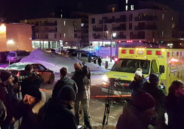 "Six people were reportedly killed by gunmen Sunday night during Evening Prayers at the Islamic Cultural Center of Québec City, Canada. By midnight, police reported that two gunmen had been arrested. Prime Minister Justin Trudeau called the slaughter ""a terrorist attack on Muslims."" (Mathieu Belanger/Reuters)"