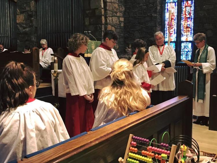 Acolytes were commissioned on Sunday at Grace Church, Brunswick, Maryland, by the rector, the Rev. Anjel Scarborough, with Senior Warden Al Horton keeping an eye on them. We know their names - Jordan, Christina, Miriam (behind seated crucifer), Millie and Gabriel, and we can see four of the five - but that's Miriam, who isn't very tall yet, hidden by the crucifer in front of her, even though he's sitting down. (Parish photo)