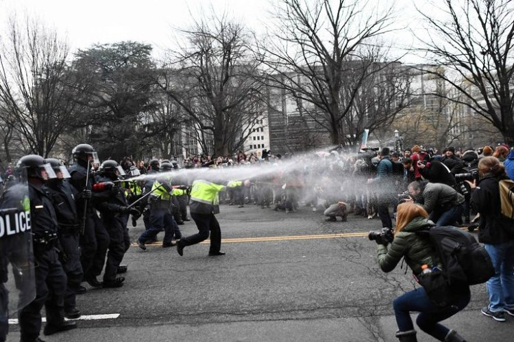 Pepper-spraying demonstrators during the U.S. presidential inauguration 10 days ago; we haven't seen this before. (Jewel Samad/Agence France-Presse)
