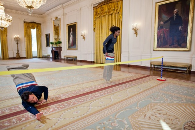 A sack race across the East Room of the White House, with George Washington calling Michelle Obama the winner over comedian and talk show host Jimmy Fallon. No matter what you've heard about the Obamas, she remains the most admired woman in America, not least because of episodes like this. (Chuck Kennedy/The White House)