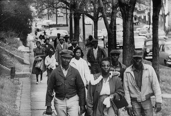 An early shot of the Montgomery, Alabama bus boycott in 1955, the same period when Willie Evans was playing ball at the University of Buffalo. Rosa Parks and the women of Montgomery's black community kicked off the boycott by refusing to sit in the back of city buses - which meant everyone had to walk or catch a ride. This is the campaign that launched Martin Luther King, Jr. as a national civil rights leader. The white businessmen of Montgomery held out for a year, and then they caved like a castle in the sand. But the work was only beginning, as we know. (uncredited news photo)