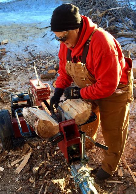 Mother Lauren splitting wood: this is a priest. Every log she runs through - and she has a great group of helpers led by layman Danny Langone - helps save a life on the Rosebud Indian Reservation in South Dakota, where a few thousand Lakota Sioux live in desperate poverty in one of the harshest environments in the United States. People freeze to death in their homes every winter, so this is the pure work of mission. (Rosebud Episcopal Mission)