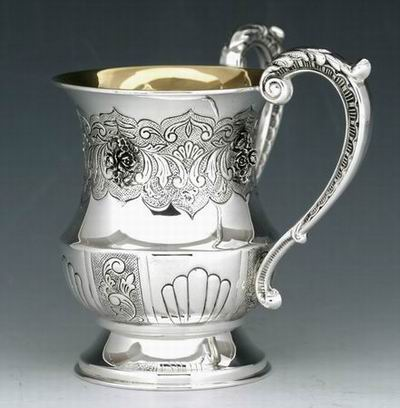 A silver washing cup used by Orthodox Jews for ablutions before eating bread; they have to use enough water to get their middle knuckle wet, or it doesn't count. (Wikipedia)