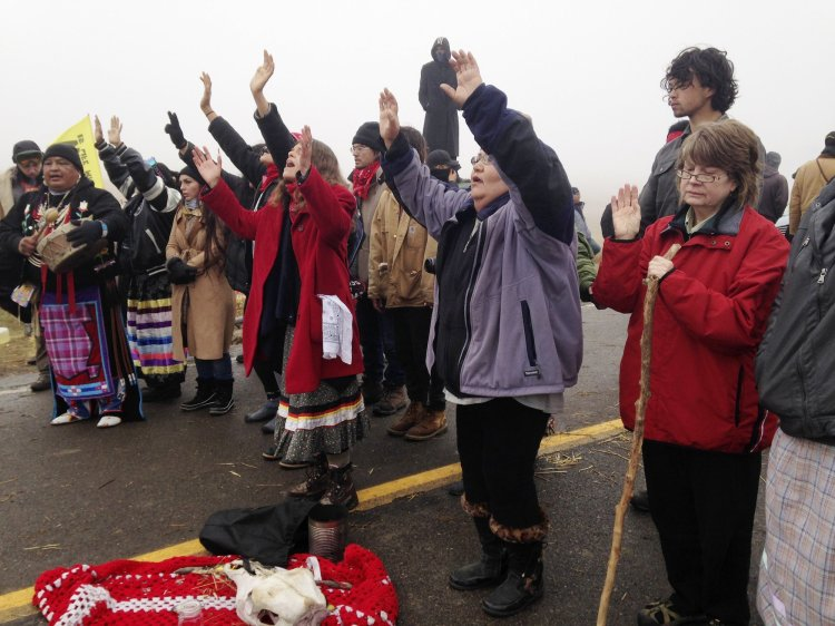 A state representative in North Dakota named Keith Kempenich has introduced a bill to legalize running over protesters who block highways, aimed at Native Americans and others at the Standing Rock Indian Reservation. Water protectors, as they style themselves, have engaged in a yearlong peaceful battle to prevent a giant oil pipeline from being built under the Missouri River just outside the reservation's current borders, on land that was once guaranteed to them by the U.S. government, until the white people stole it back again. This minor politician claims his elderly mother was surrounded and intimidated one day while driving past the site. He says the driver would have to try to avoid hitting people, but if they accidentally kill someone it's not their fault. The Obama Administration has blocked the pipeline at that location, but the white ranchers, whose ancestors stole the land 150 years ago, give every indication they demand revenge. (Sacred Stone Camp)