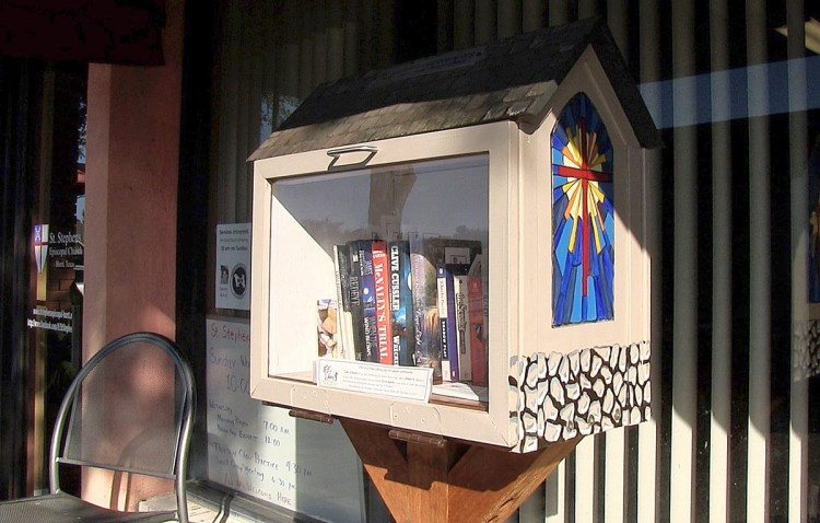 The tiny free library oustide St. Stephen's, Hurst, Texas, a congregation recovering nicely from the anti-Gay schism ten years ago in the Diocese of Fort Worth and the subject of this evening's video; see below. (The Rev. Mary Frances Schjonberg/Episcopal News Service)