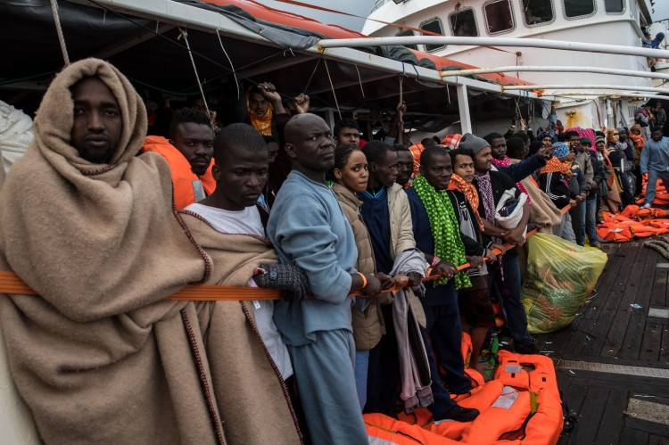 The bodies of 70 migrants washed ashore in western Libya Monday. (David Ramos/Getty Images)