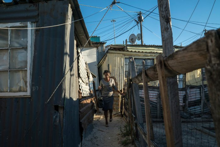 South Africa, faced with some of the world's worst income inequality, is considering establishing a minimum wage for the first time, though at such a low rate it would not benefit many workers, who also contend with housing segregation and high transportation costs. Khayelitsha, a vast township located between two wealthy white areas, provides an example; 27 years after ANC's revolution, blacks still earn one-fifth what whites do. (Joao Silva/The New York Times)