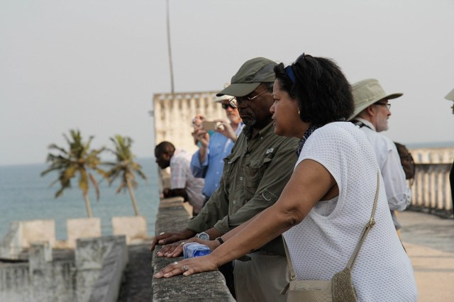 """Episcopal Presiding Bishop Michael Curry led a pilgrimage to Ghana last month to visit historic sites used in the slave trade and The Episcopal Church's efforts through its Relief and Development fund to build up the local economy. Above, the PB and Massachusetts Suffragan Bishop Gayle Harris take a look at one of the European """"castles"""" which lined the coast for centuries to serve the slave trade's Middle Passage. Human beings were kidnapped in the countryside, taken to camps, then marched to the sea to be loaded onto ships destined for the Southern U.S. and Caribbean islands. (Reportage and photos by Lynette Wilson/Episcopal News Service)"""