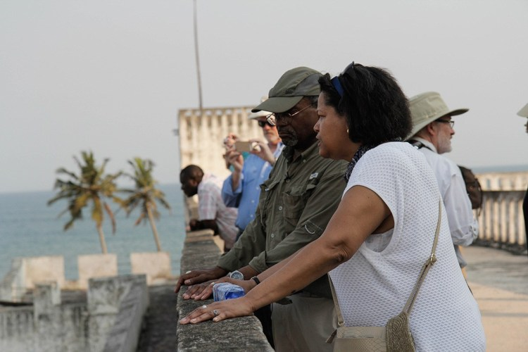 "Episcopal Presiding Bishop Michael Curry led a pilgrimage to Ghana last month to visit historic sites used in the slave trade and The Episcopal Church's efforts through its Relief and Development fund to build up the local economy. Above, the PB and Massachusetts Suffragan Bishop Gayle Harris take a look at one of the European ""castles"" which lined the coast for centuries to serve the slave trade's Middle Passage. Human beings were kidnapped in the countryside, taken to camps, then marched to the sea to be loaded onto ships destined for the Southern U.S. and Caribbean islands. (Reportage and photos by Lynette Wilson/Episcopal News Service)"