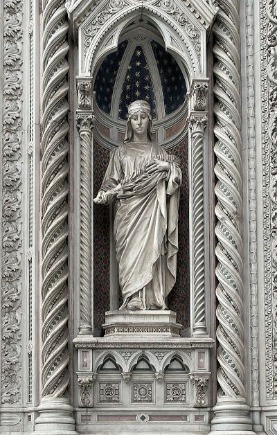 Statue of St. Reparata at the Duomo in Florence, Italy; if she existed she was a 4th Century virgin and martyr, patroness of Florence until the 1200s,  when someone decided to depose her and install the Virgin Mary and John the Baptist in her place. But she got this lovely statue as a parting gift. (Wikipedia)