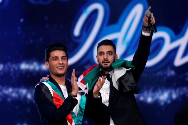 "A Palestinian Christian, Yacoub Shaheen (right), has won the televised singing contest ""Arab Idol,"" prompting joy throughout Palestine, especially in his hometown, Bethlehem. He was joined onstage Saturday night by a previous winner, Mohammed Assaf of the Gaza refugee camp, now one of the biggest stars of Arabic music. (Reuters)"